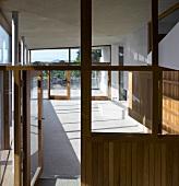 View through glass door into loggia of a contemporary house