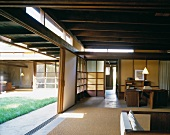 Japanese-style wooden house with view of courtyard through open sliding door