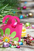 Pink felt bag with chocolate Easter eggs
