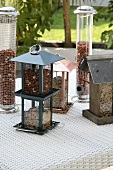 Bird feeders and feeding stations on a table