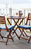 Round table with two folding chairs on balcony
