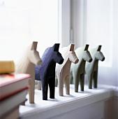 Carved wooden horses on windowsill (Dala horses)