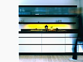 Kitchen unit with yellow lighting