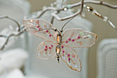 Christmas tree decoration - butterfly ornament hanging from twig