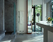 Designer bathroom with marble shower area
