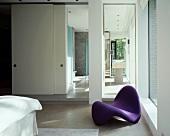 Violet designer couch in bedroom with ensuite bathroom