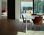 Brown leather chairs at dining table in modern living space