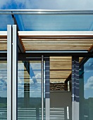 Detail of designer house with glass facade