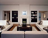 Living room with upholstered seating and fitted bookcases