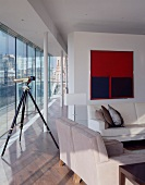 Telescope in living room of penthouse apartment