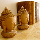 Plaster Buddha's heads on shelf