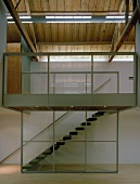 View from living room of staircase separated by glass wall
