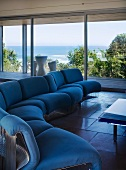 Blue sofa in living room with sea view