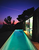 Terrace with swimming pool at dusk