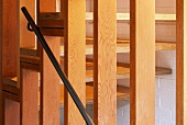 Wooden slatted partition in stairwell