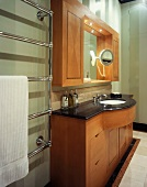 Wooden washstand with black stone top and matching wall cabinet