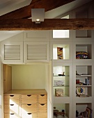 Niche with fitted shelving and storage drawers