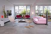 Large, open living room with a pink couch