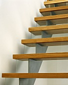 Wooden stair treads on stainless steel stringer