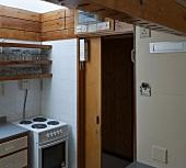 Functional kitchen with open wooden sliding door