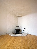 Kettle on hearth in Japanese tea house