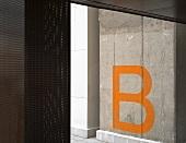 Letter B on concrete pillar