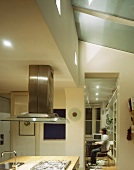 Kitchen with island and extractor hood