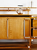 Retro silver teapot and intricate beech sideboard with white borders