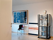 Modern painting and exhibition display case with collectors' items