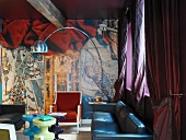 Dramatic living room decor with contemporary arc lamp above seating area in colourful mix of styles