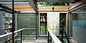 Contemporary solar house building - gallery level with open sliding roof