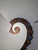 Top view of stairwell with wooden spiral staircase