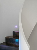 Wooden spiral staircase with white balustrade & integrated lights