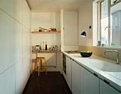 White kitchen with shelves & stool
