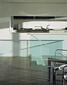 View of kitchen through serving hatch