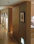 A long corridor hung with pictures and a view into the kitchen