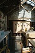 Open-plan kitchen with wooden partition & wood & glass roof structure