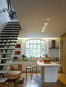 Open-plan kitchen & floating staircase