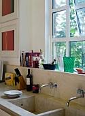 Kitchen sink with various utensils