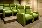 Three rows of green cinema seats