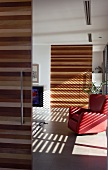 Sliding doors made of various types of wood in open-plan interior