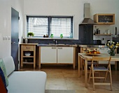 Modern, rustic kitchen with dining area