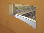 Window aperture in curved wooden wall