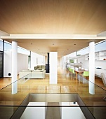 Open-plan interior with dining area in contemporary house