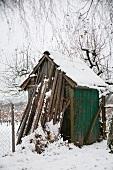 Shed in snowy garden
