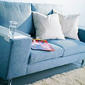 Cushions and a glass of water on a sofa