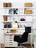 Work station with shelving on wall