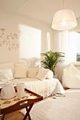 Scandinavian living room in white textiles