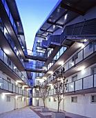 Apartment blocks with exterior walkways and glass bridges
