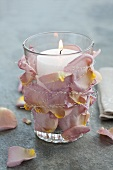 Glass with rose petals and candle